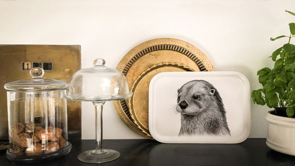 otter on wooden tray