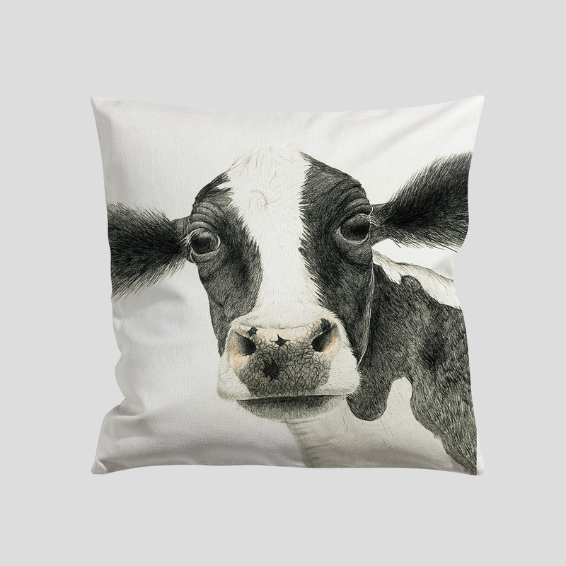 A black and white cow on a cushion - by Charlotte Nicolin