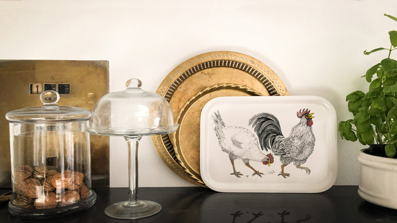 hen and rooster on wooden tray