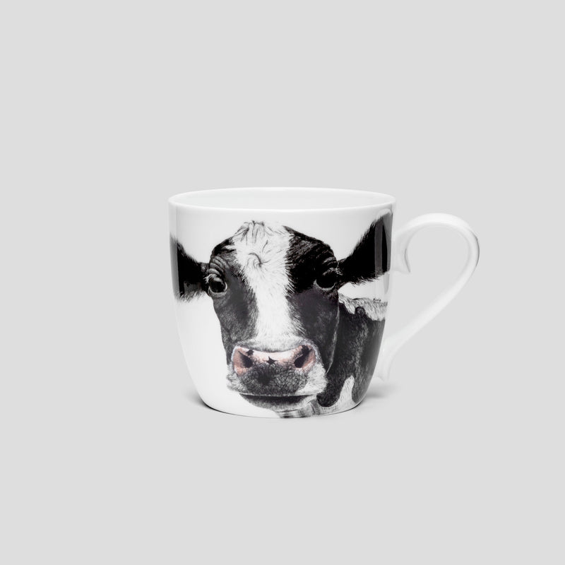 A black and white cow on a mug / cup - by Charlotte Nicolin