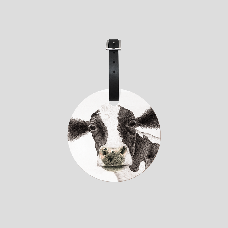 A black and white cow on a address tag - by Charlotte Nicolin