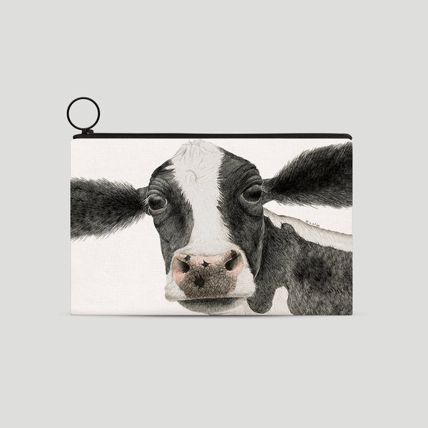 A black and white cow on a purse - by Charlotte Nicolin