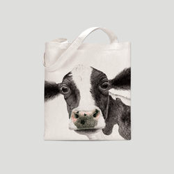 A black and white cow on a tote bag  - by Charlotte Nicolin