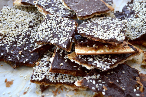 Chefanie Chocolate Matzah Toffee Pieces on Tray with Sesame Seeds