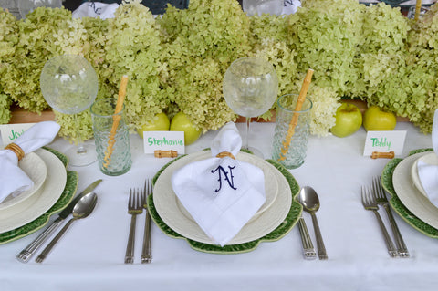 Green and white tablescape with bamboo details