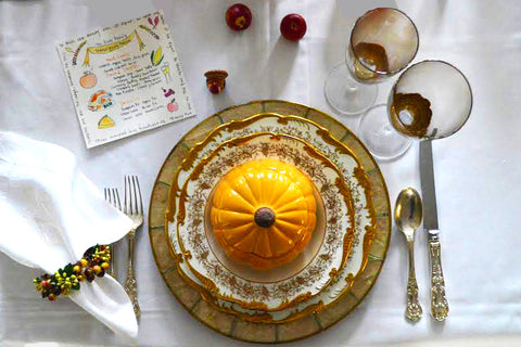Gold and Orange Thanksgiving Table Setting with Pumpkin Bowl