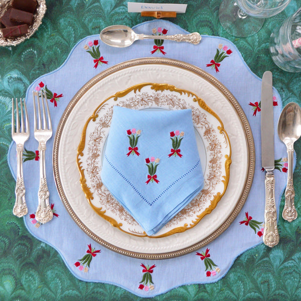 These scalloped edge, tulip embroidered, blue linen placemats (with matching napkins)