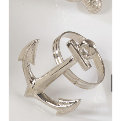 A silver napkin ring and the front is the shape of a an anchor