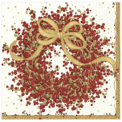 A pretty red pepperberry wreath is tied with a flowing golden bow.
