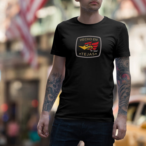 based off of the Mr. Horsepower design rounded box  with words Hecho en Tejas, with eagle biting down on a cigar. DGT quality print on Black, navy or charcoal heather gray cotton teeshirt. the heather color has some polyester