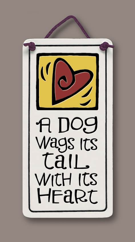 A dog wags it's tail...