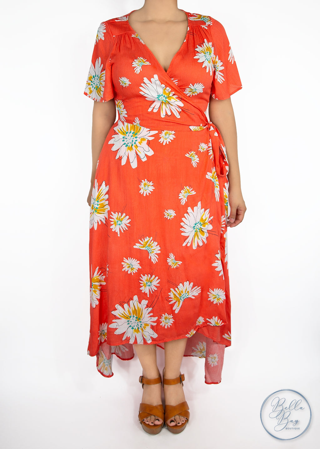 Paisley Raye Primrose Wrap Dress- Orange with White Floral (0X) - Paisley Raye with Bella Bay Boutique, shop now at  https://shopbellabay.com/ or locally in Newport Oregon