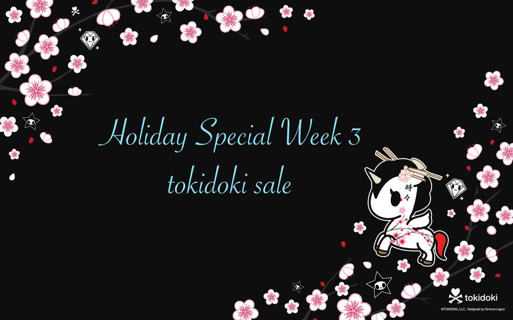 a yellow giraffe: holiday special tokidoki sale