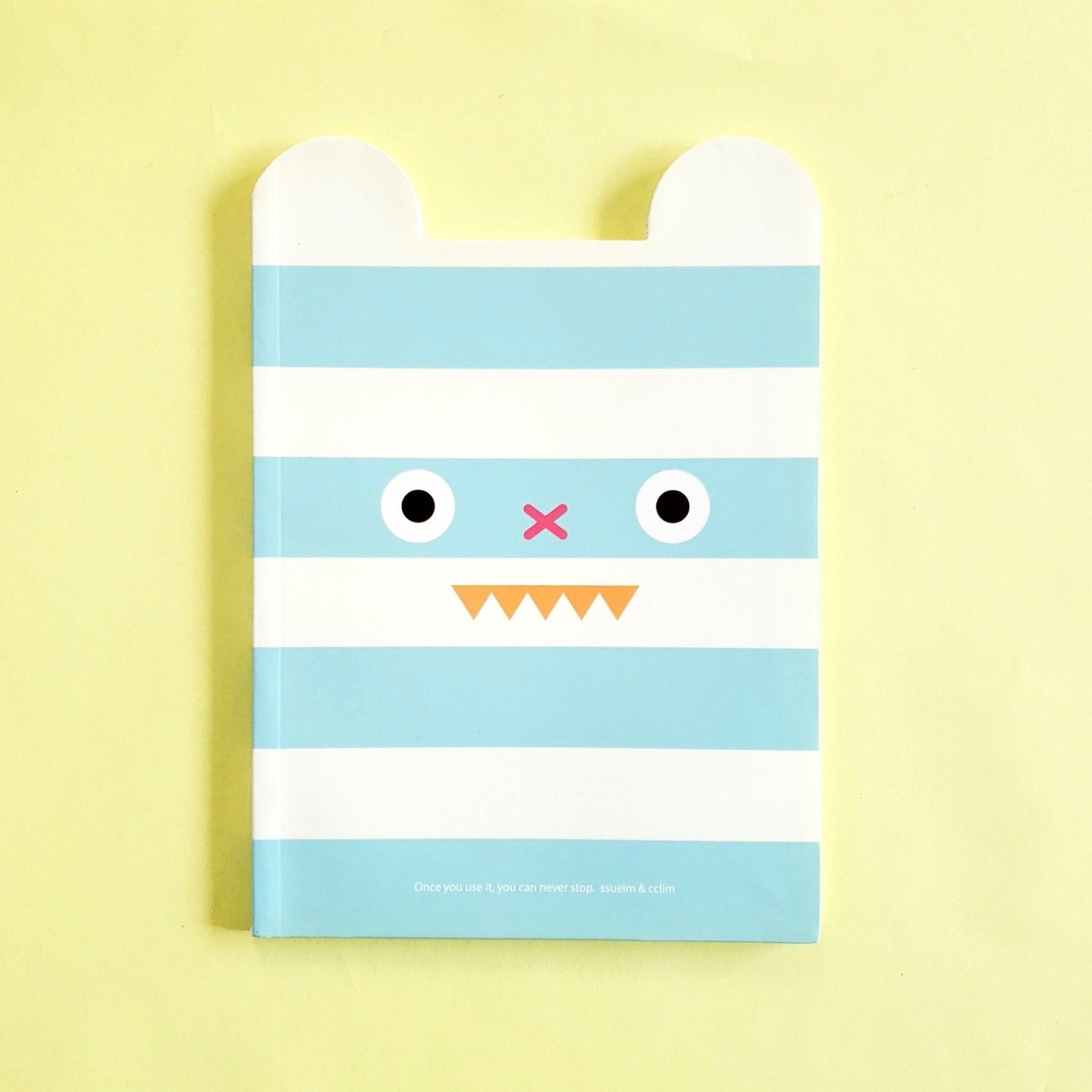 cute korean stationery by ssueim & cclim: funny mouth notebook with blue stripes (front cover)