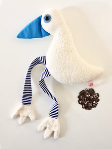 Full length overhead view of Esthex Sam Duck Blue Plushie with blue duck bill and blue and white ribbon legs, white fuzzy body and Esthex tags