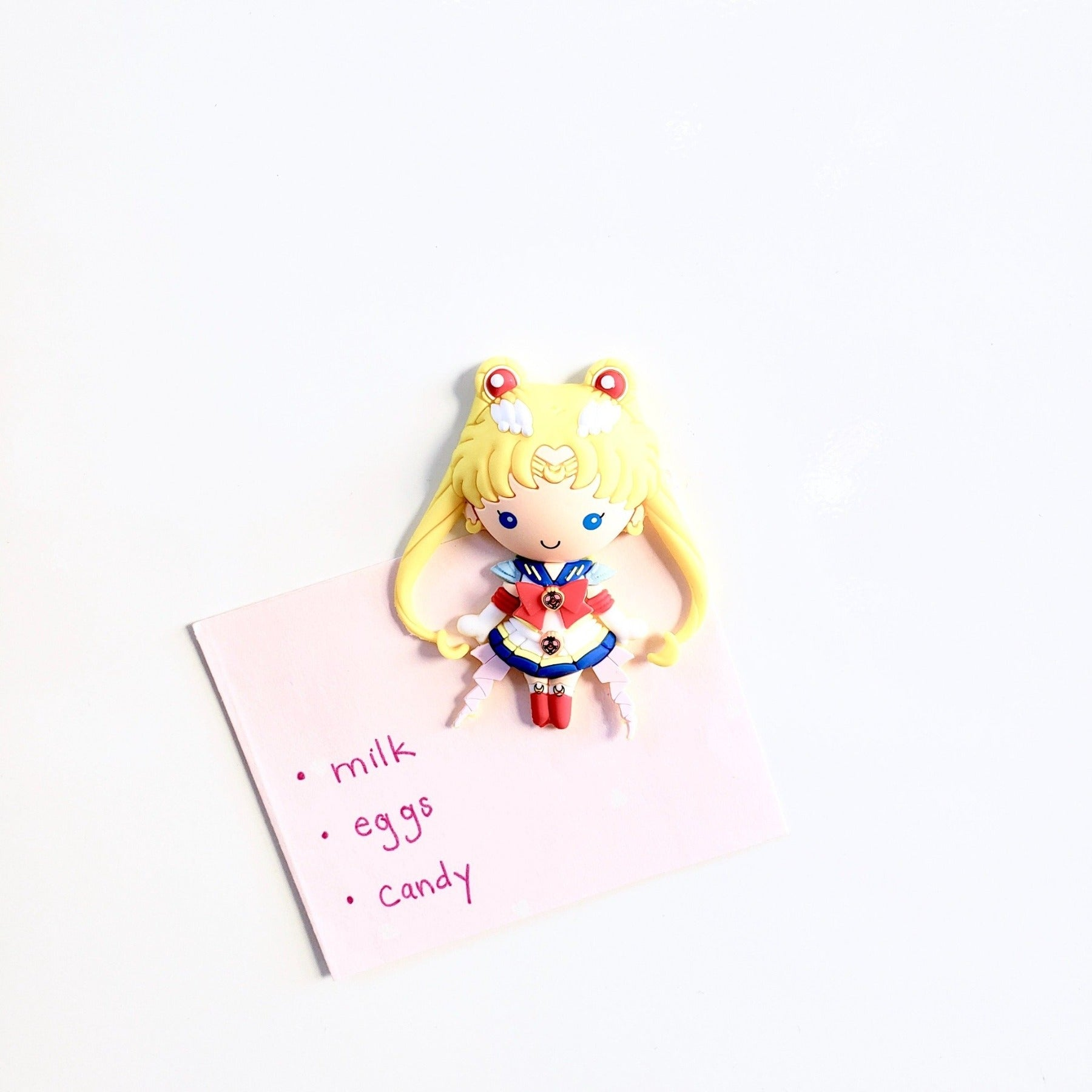 Shopping list hung on magnetic surface with Sailor Moon 3D vinyl figure magnet
