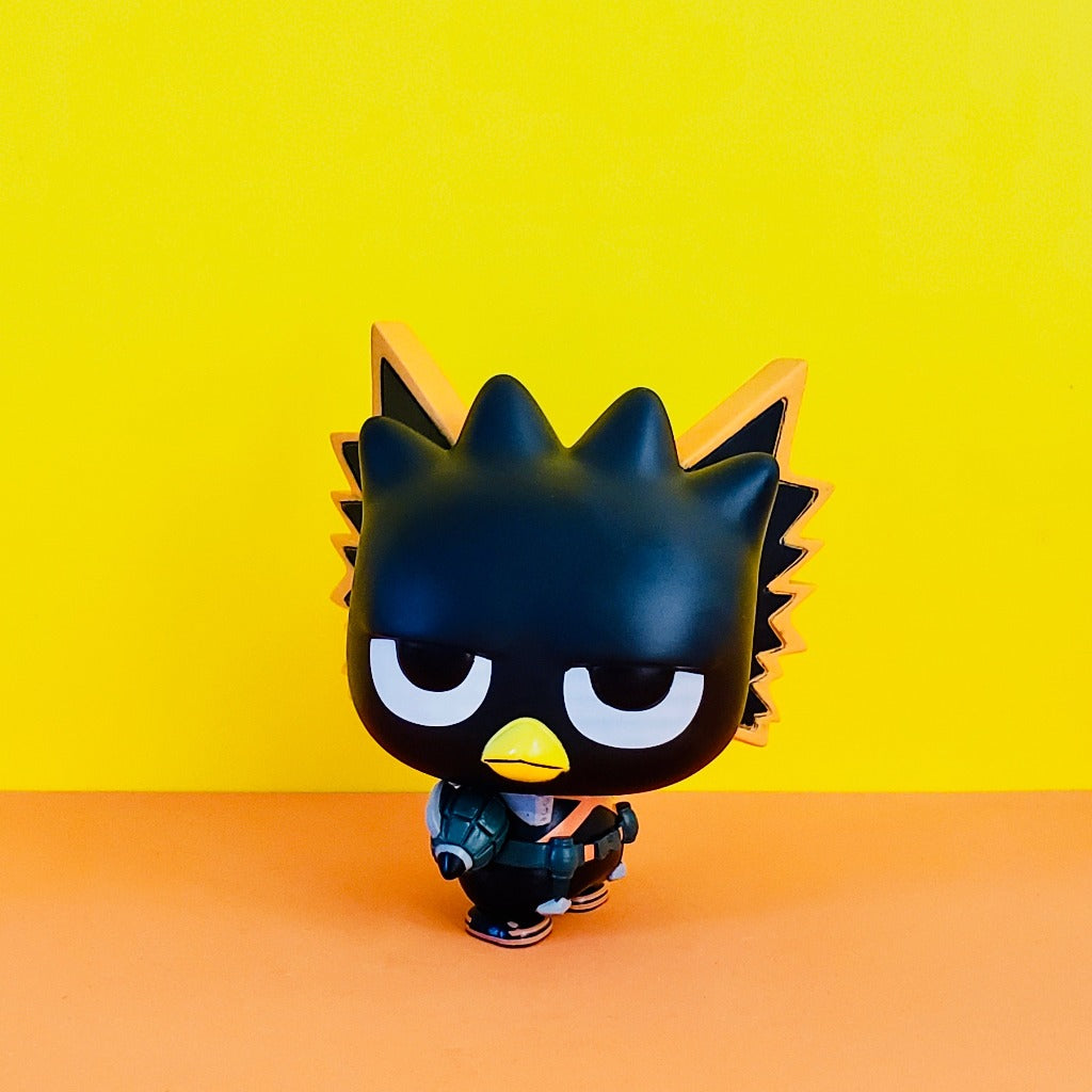 Funko POP! My Heroacademia Sanrio Badtz-Maru Katsui front view on yellow/orange background wearing Katsuki style outfit