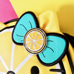 "Loungefly Hello Kitty shaped as a cute Lemon Crossbody Bag closeup on bow shaped as lemon with 2 mint green ""leaves"""