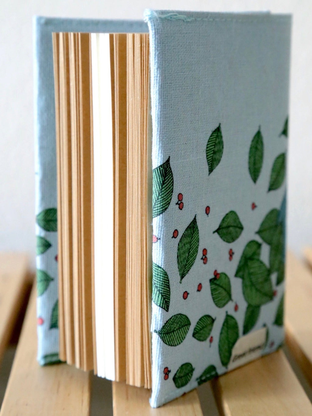 side view of great friend light blue fabric cover journal