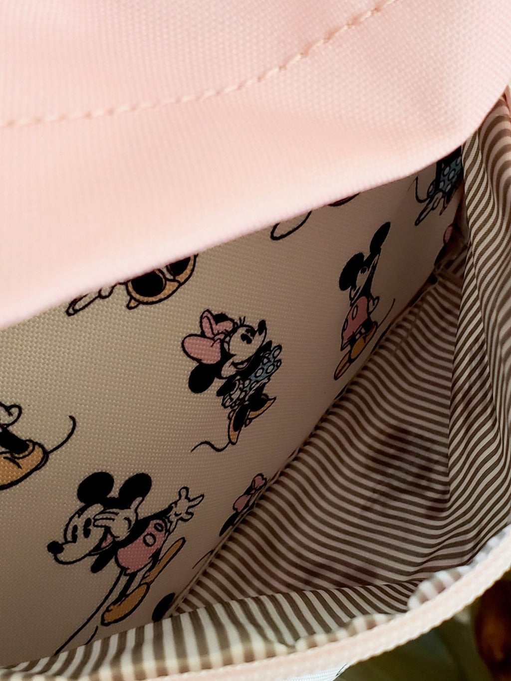 Loungefly Disney Minnie Mickey Backpack front zippered pocket open to show interior