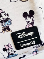 Loungefly Disney Minnie Mickey Backpack logo closeup view