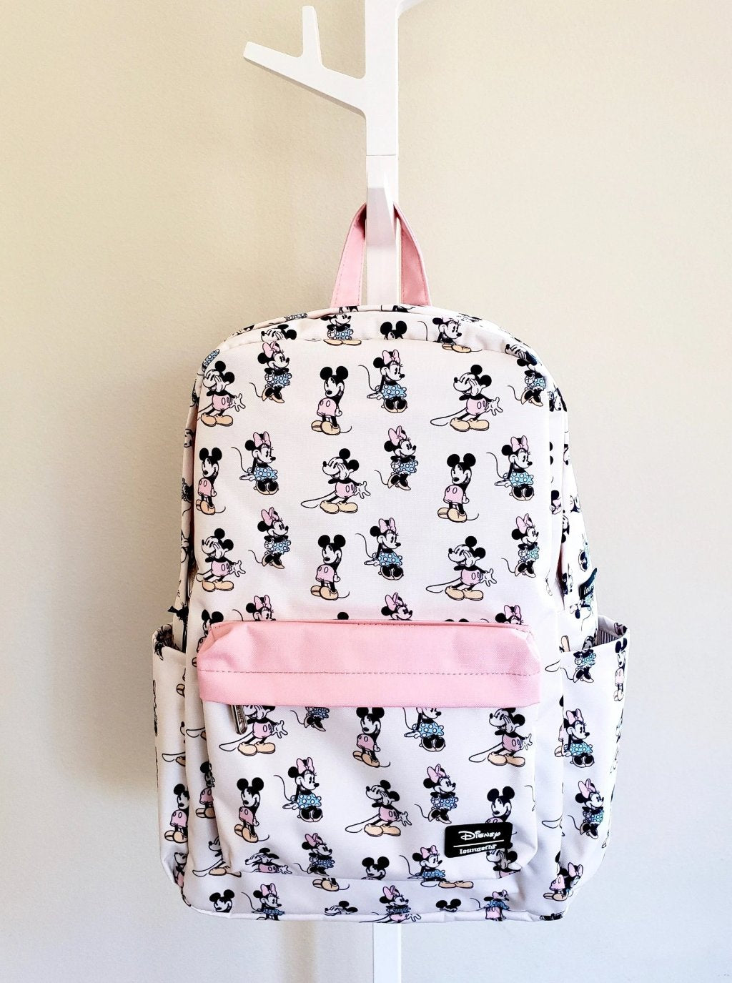 Loungefly Disney Minnie Mickey Backpack in pastel colors with all over print of Mickey and Minnie, front view