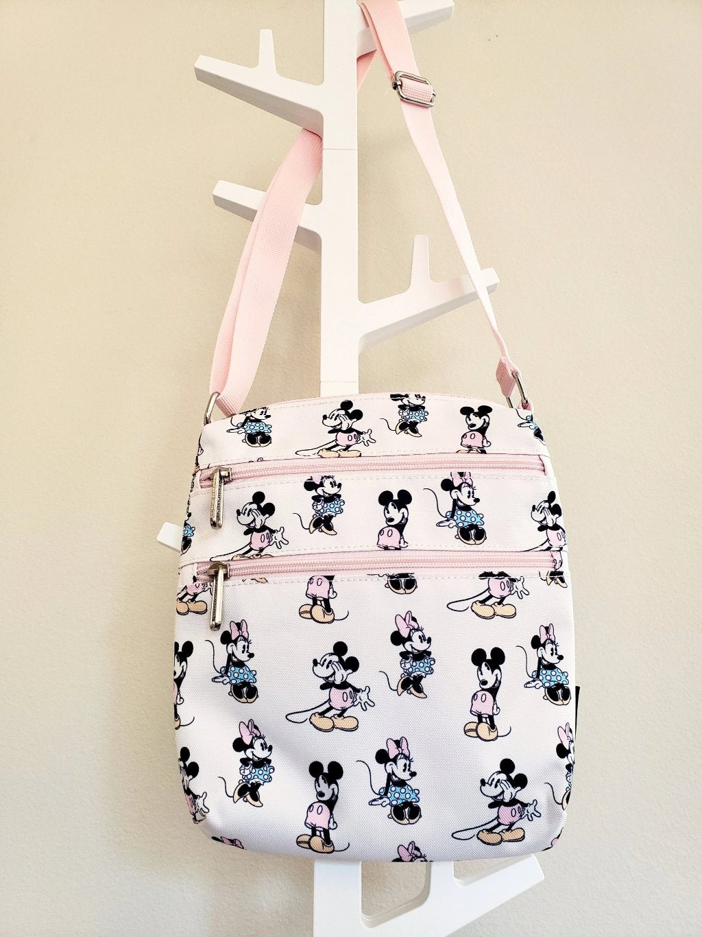 Loungefly Disney Minnie Mickey Passport Bag in pastel pink with 3 zippered compartments front view