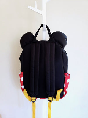Loungefly Disney Minnie Mouse black, red and white polka dotted backpack yellow adjustable straps back view