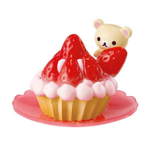 Re-Ment Korilakkuma Sweets in Dream series Korilakkuma placing a strawberry onto a tart