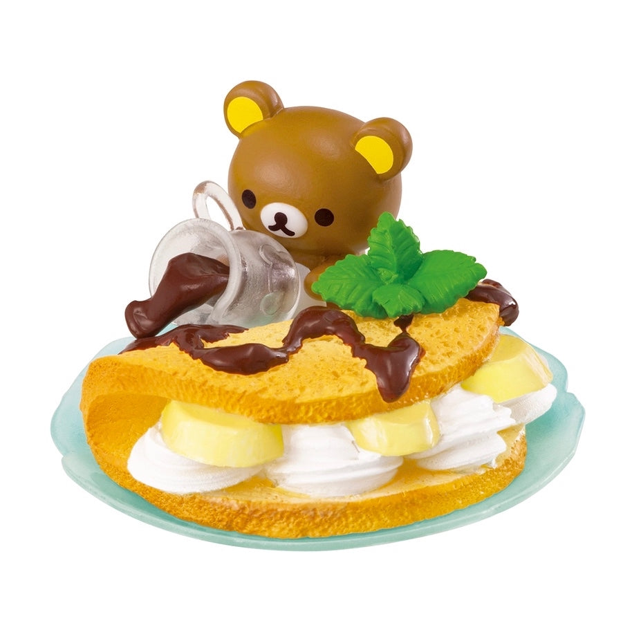 Re-Ment Korilakkuma Sweets in Dream series Rilakkuma pouring chocolate sauce on a dessert omelette