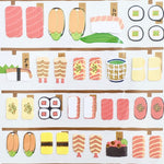 paper stickers of various sushi and japanese side dishes with gold accents