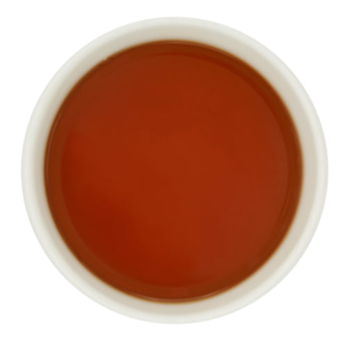 Bright ruby liquor of Halmari Estate's Assam tippy tea.