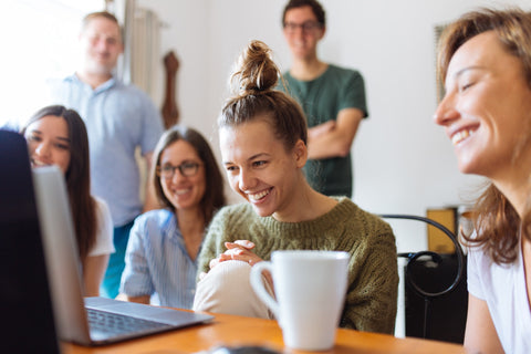 Happy people communicating at work