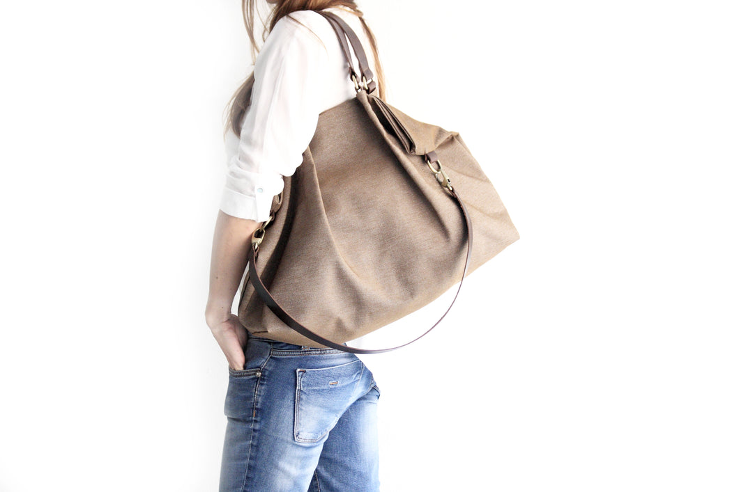 Susy Canvas and leather shoulder bag, made of water resistant canvas and leather