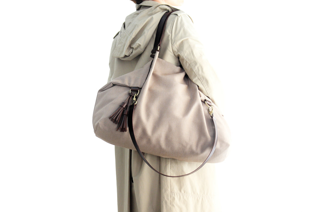 Canvas and leather shoulder bag, made of water resistant canvas light brown and leather. Susy shoulder bag