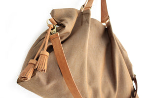 Canvas and leather shoulder bag, made of WATER RESISTANT fabric brown and leather. Susy shoulder bag