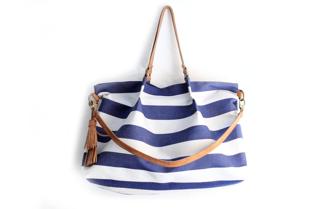 Canvas and leather shoulder bag, made of water resistant fabric striped blue and leather. Susy shoulder bag
