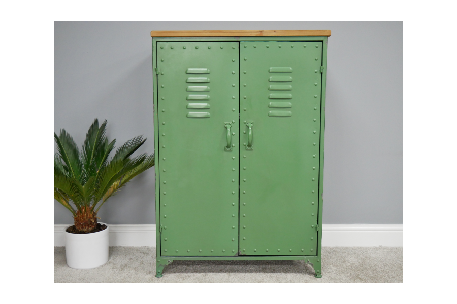 Wood topped green metal industrial storage cabinet.