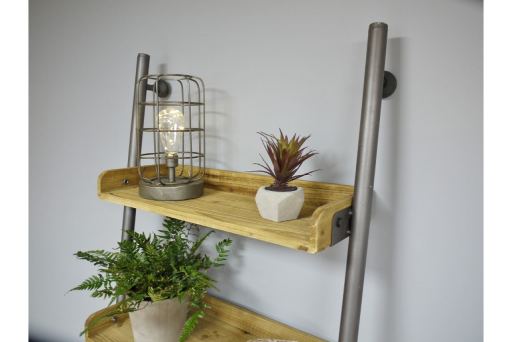 Steel pipe and wood industrial ladder shelving unit.
