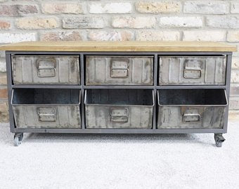 Industrial steel drawer cabinet with wood top.