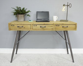 Industrial wood desk with metal legs.