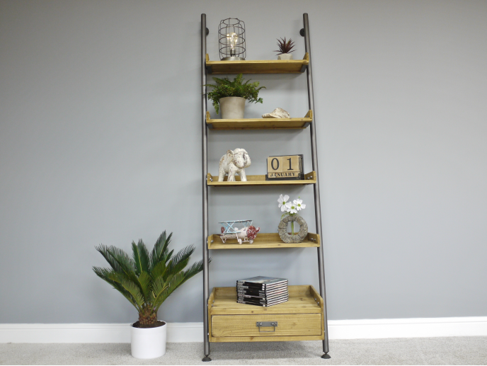 Tall Steel pipe and wood industrial ladder shelving unit.
