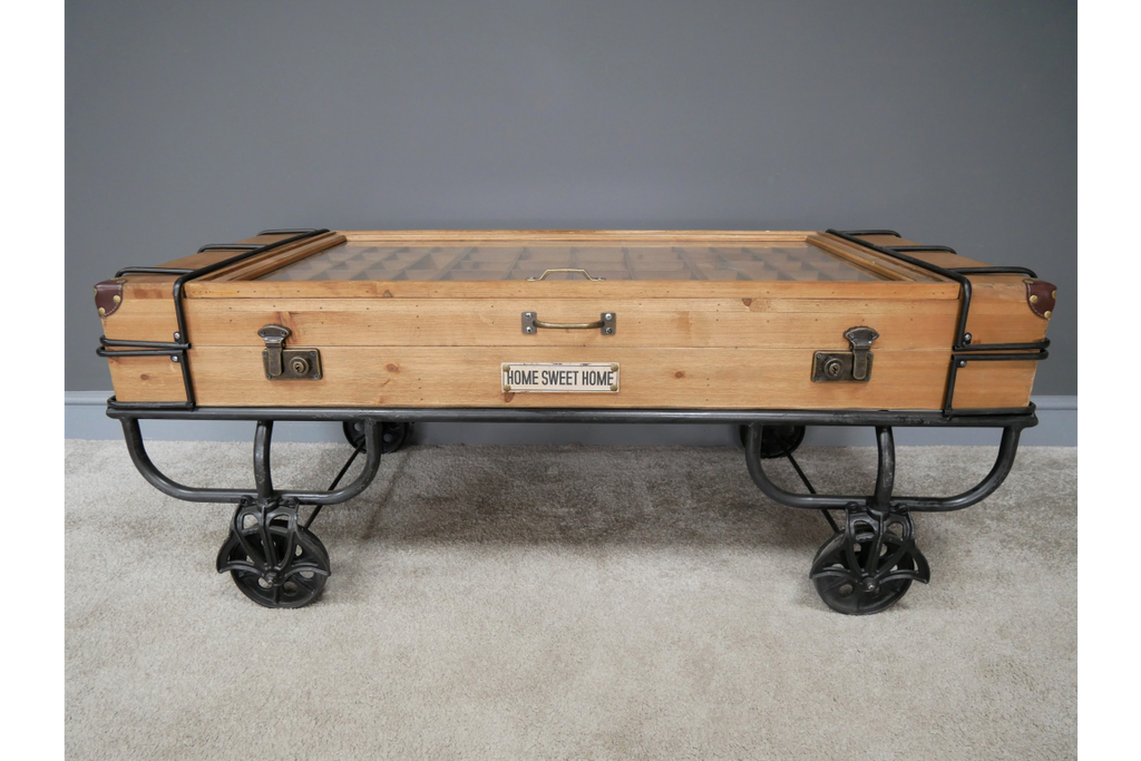 Large Industrial trunk coffee table on wheels.