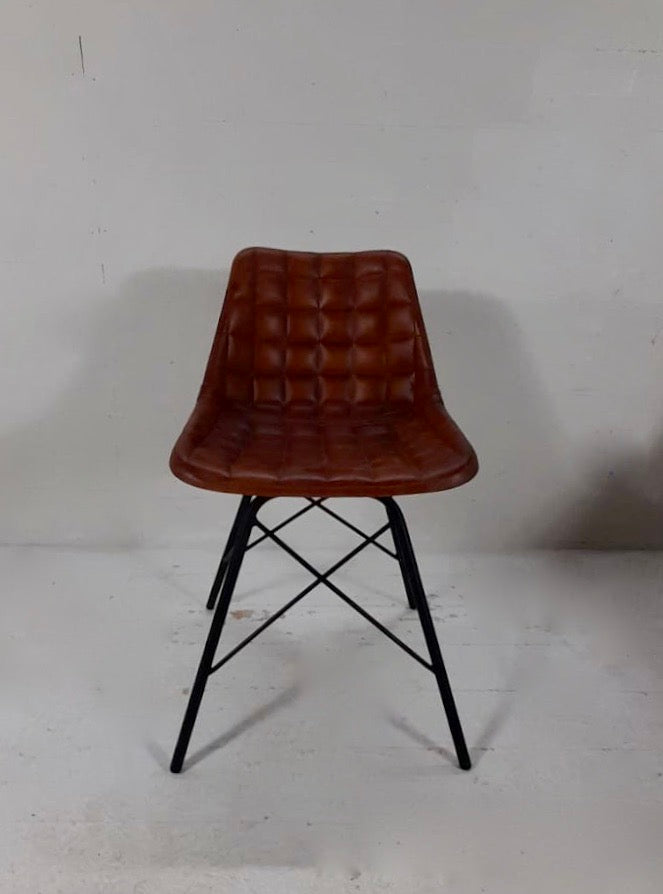 Set of Industrial retro Bruciato leather dining chairs.