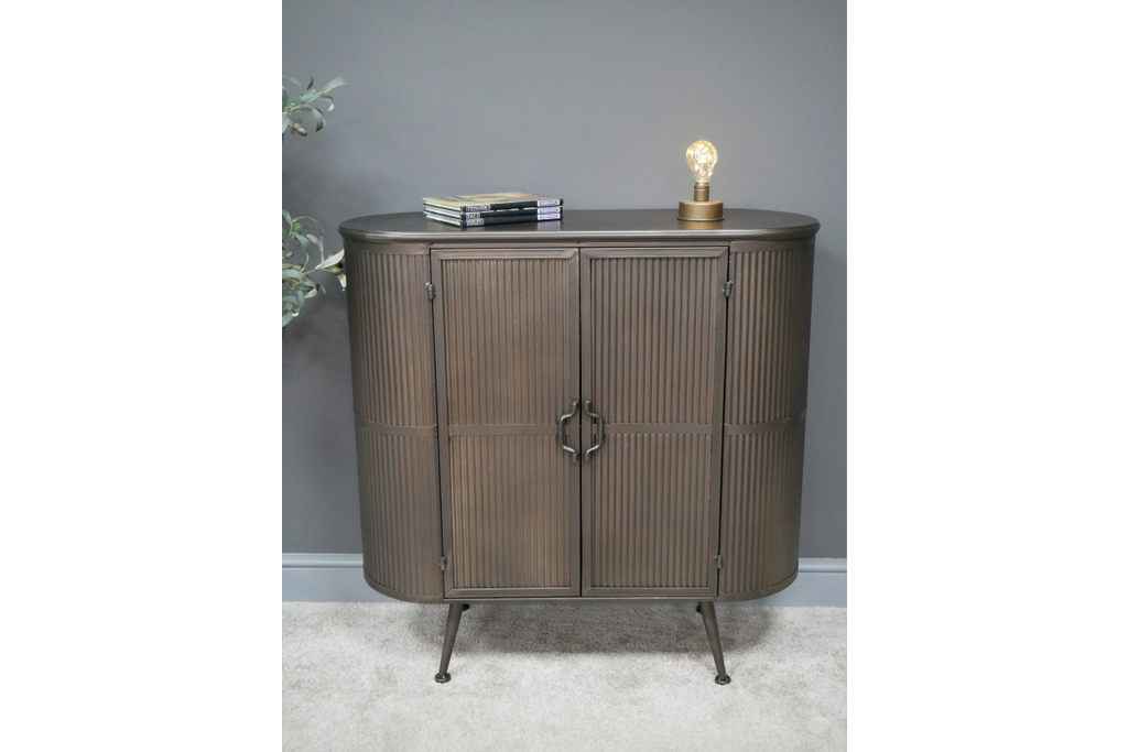Ribbed metal industrial retro storage cabinet.