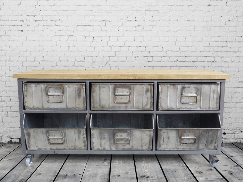 Industrial steel drawer storage cabinet with wood top.