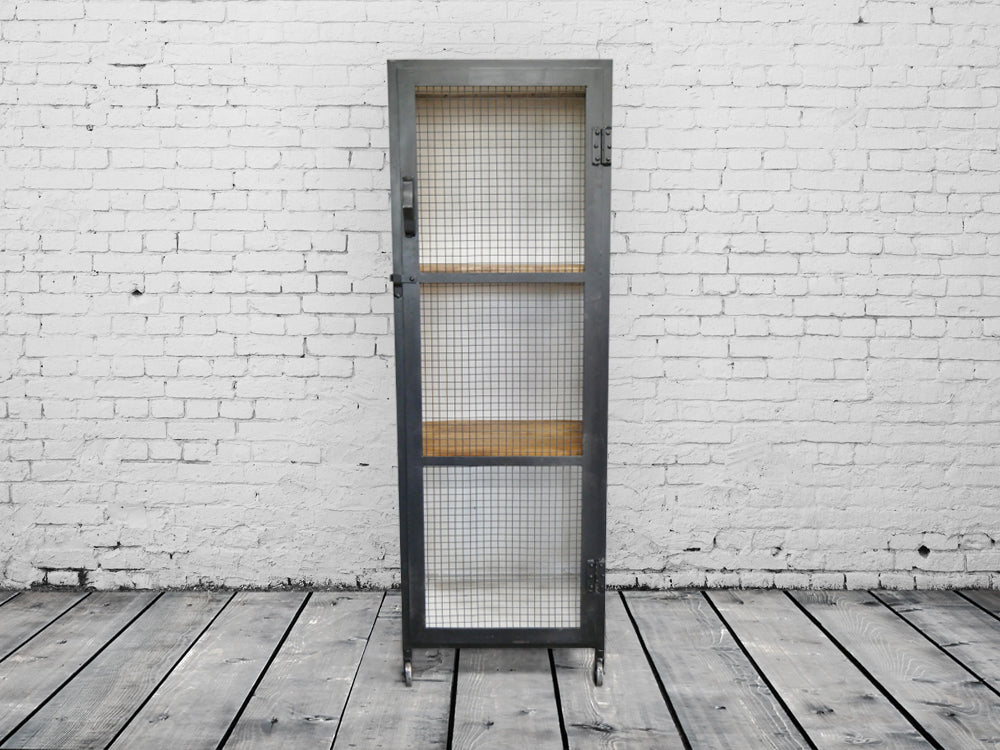 Tall Iron Industrial mesh fronted storage locker.