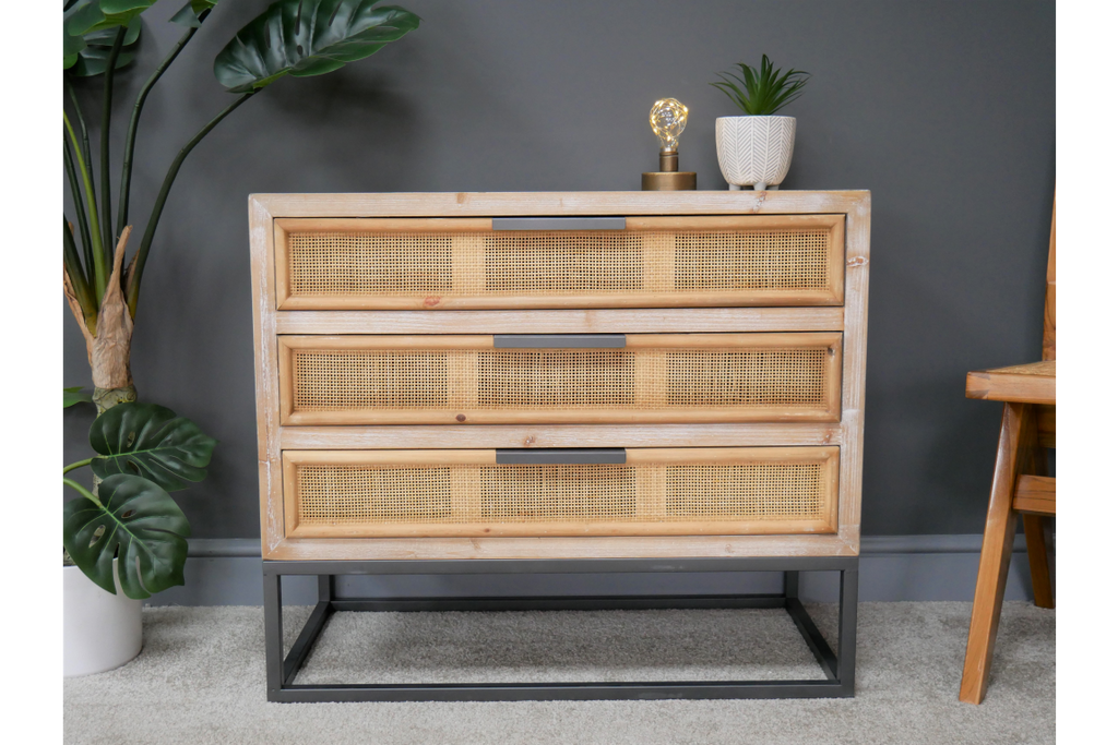 Wood & rattan chest of drawers.