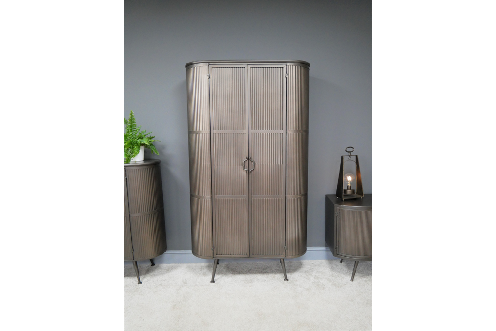 Tall ribbed metal industrial retro storage cabinet.
