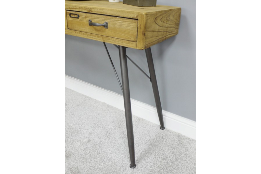 Solid wood desk with metal legs.